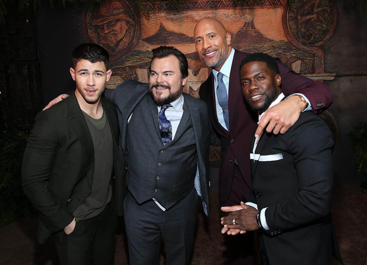 HOLLYWOOD, CA - DECEMBER 11: (L-R) Nick Jonas, Jack Black, Dwayne Johnson, and Kevin Hart attend the premiere of Columbia Pictures' 'Jumanji: Welcome To The Jungle' on December 11, 2017 in Hollywood, California. (Photo by Phillip Faraone/Getty Images)