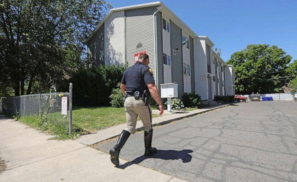 PHOTO: A police officer walks to a building where a man was taken into custody in connection with missing University of Utah student MacKenzie Lueck Friday, June 28, 2019, in Salt Lake City. (Rick Bowmer/AP)
