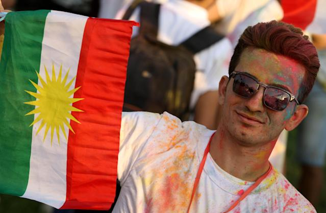 <p>An Iraqi Kurd holds a Kurdish flag during an event to urge people to vote in the upcoming independence referendum in Arbil, the capital of the autonomous Kurdish region of northern Iraq, Sept. 15, 2017. (Photo: Safin Hamed/AFP/Getty Images) </p>