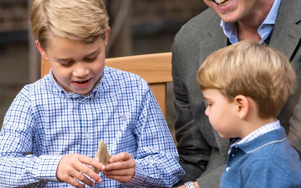 Prince George and his megalodon tooth, which the Maltese Government has asked to be returned
