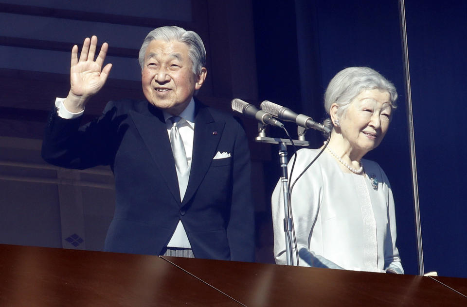 Japan's Emperor Akihito and Empress Michiko greet to well-wishers from the bullet-proofed balcony during their New Year's public appearance with family members at Imperial Palace in Tokyo Wednesday, Jan. 2, 2019. (AP Photo/Eugene Hoshiko)