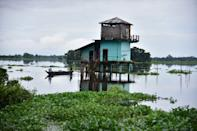 A submerged watch tower in flooded Kaziranga national park in Nagaon District of Assam. (Photo credit should read Anuwar Ali Hazarika/Barcroft Media via Getty Images)