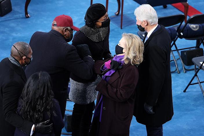 <p>Former Secretary of State Hilary Rodham Clinton elbow bumps Congressman Jim Clyburn as she arrives with her husband, former President Bill Clinton.</p>