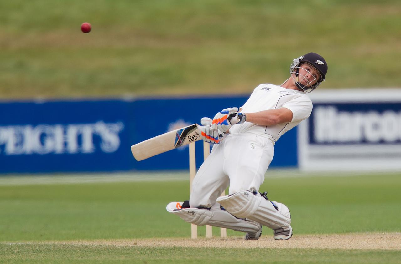 New Zealand's BJ Watling dodges the ball on the last day of the four day warm-up international cricket match between New Zealand XI and England in Queenstown on March 2, 2013.   AFP PHOTO / Marty MELVILLE        (Photo credit should read Marty Melville/AFP/Getty Images)
