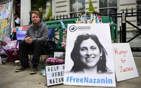 Richard Ratcliffe, the husband of imprisoned Nazanin Zaghari-Ratcliffe, protesting outside the Iranian Embassy in London - Credit: Rex