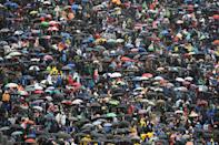 Umbrellas go up as the rain comes down (Photo by OLI SCARFF/AFP/Getty Images)