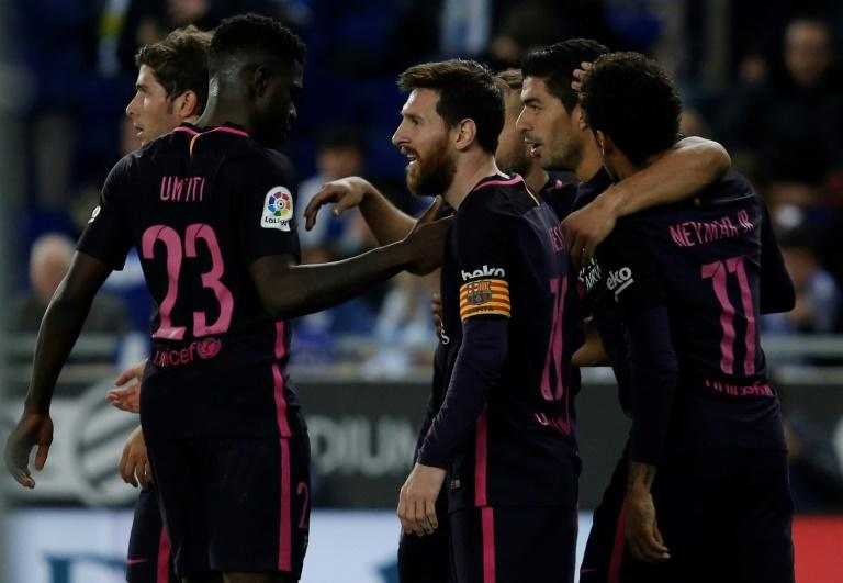Barcelona's Luis Suarez (2ndR) celebrates with teammates after scoring his team's third goal during their Spanish league football match against Espanyol on April 29, 2017