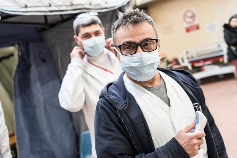 With the exceptions of health-care workers, like these two at the Molinette Hospital in Turin, Italty, and people who are exhibiting symptoms of respiratory illness, face masks are not recommended. (Photo: Stefano Guidi via Getty Images)
