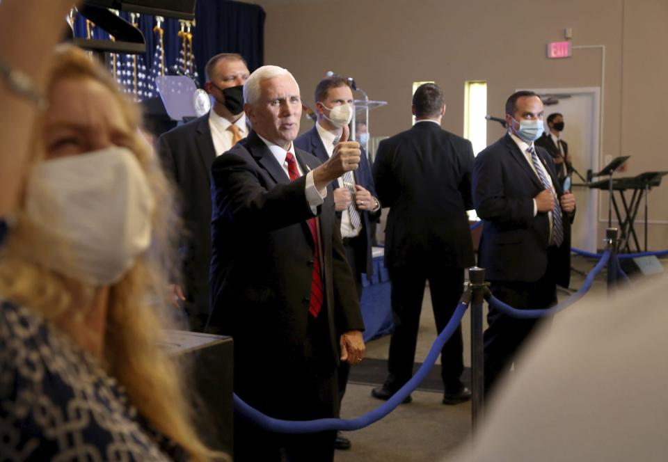 Vice President Mike Pence acknowledges a crowd who gathered to hear his speech at Starkey Road Baptist Church on Wednesday Aug. 5, 2020, as part of his 'Faith in America' tour. His visit comes just days after President Donald Trump came to Tampa Bay on Friday for a campaign fundraiser. Pence's speech heralded the Trump Administration's successes and commitment to pro-life issues. (Douglas R. Clifford/Tampa Bay Times via AP)