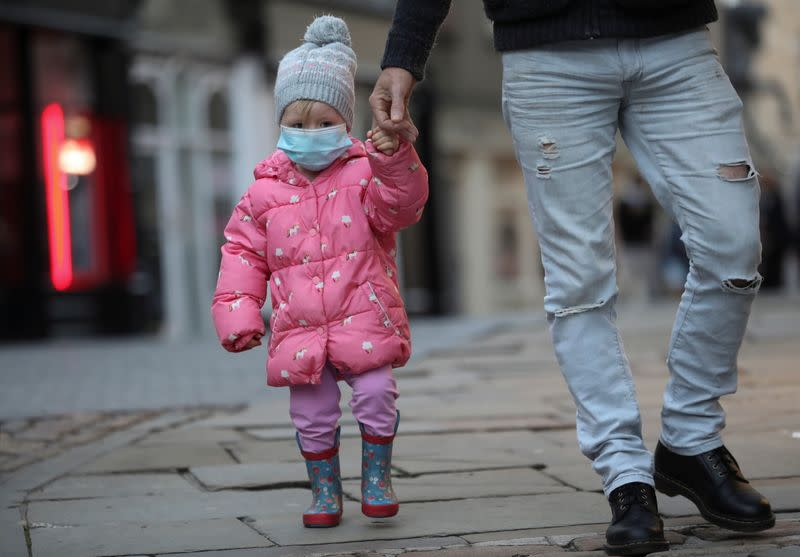 A child wears a mask as the spread of the coronavirus disease (COVID-19) continues in Durham
