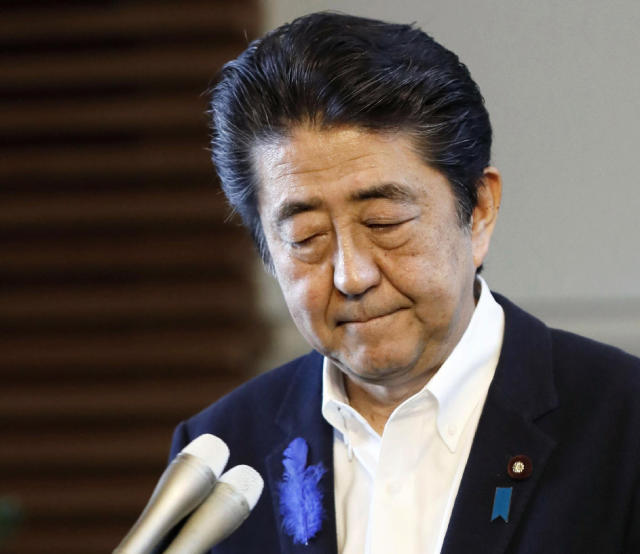 Japanese Prime Minister Shinzo Abe speaks at his official residence after announcing his government not to appeal against damages ruling in leprosy suit, in Tokyo Tuesday, July 9, 2019. Japan says it will not challenge the recent court ruling awarding damages to former leprosy patients' families for their suffering from discrimination caused by the government's failure to end its isolation policy. (Yohei Kanasashi/Kyodo News via AP)