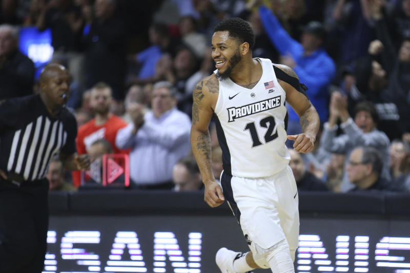 Providence's Luwane Pipkins (12) celebrates a three-pointer during the first half of an NCAA college basketball game against Marquette Saturday, Feb. 22, 2020, in Providence, R.I. (AP Photo/Stew Milne)