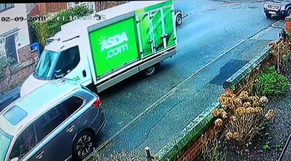 The Asda van was caught on CCTV (Picture: SWNS)