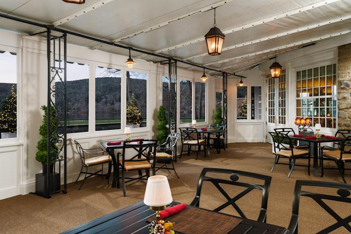 For more than a century, the Otesaga Resort in Cooperstown, New York, has closed for the winter, but with the addition of this Winter Garden Room extension, it is staying open year-round for the first time. The walls come down in warm weather for increased outdoor dining.