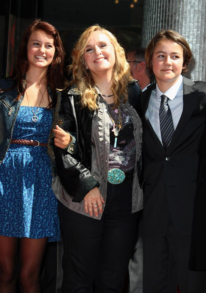Melissa Etheridge poses with daughter Bailey Jean and son Beckett in 2011 while receiving her star on the Hollywood Walk of Fame.