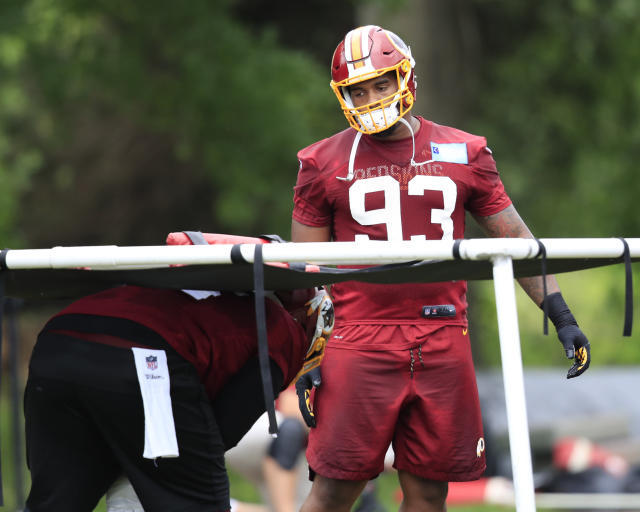 Redskins defensive guard Jonathan Allen (93) works with Daron Payne, left, during the NFL football team's full practice session at the Redskins Park in Ashburn, Va., Wednesday, May 30, 2018. (AP Photo/Manuel Balce Ceneta)