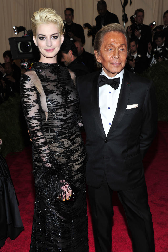 """Anne Hathaway, left, and Valentino Garavani attends The Metropolitan Museum of Art's Costume Institute benefit celebrating """"PUNK: Chaos to Couture"""" on Monday May 6, 2013 in New York. (Photo by Charles Sykes/Invision/AP)"""