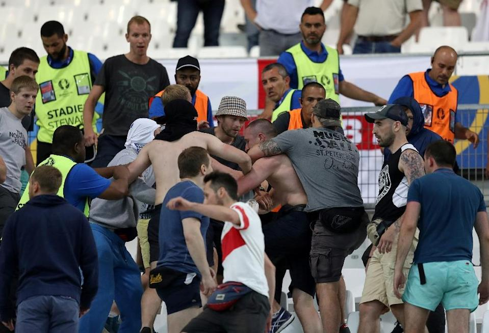 Groups of supporters fight at the end of the Euro 2016 group B football match between England and Russia at the Stade Velodrome in Marseille on June 11, 2016 (AFP Photo/Valery Hache)