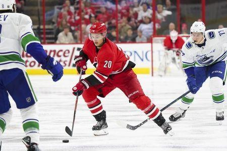Oct 9, 2018; Raleigh, NC, USA; Carolina Hurricanes right wing Sebastian Aho (20) skates with the puck against the Vancouver Canucks at PNC Arena. The Carolina Hurricanes defeated the Vancouver Canucks 5-3. Mandatory Credit: James Guillory-USA TODAY Sports
