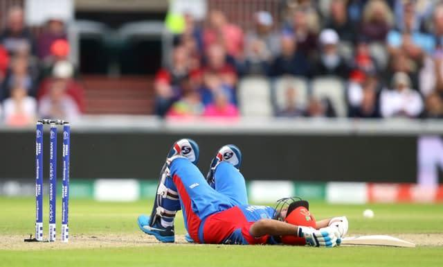 Hashmatullah lies on the ground at Old Trafford (Tim Goode/PA)