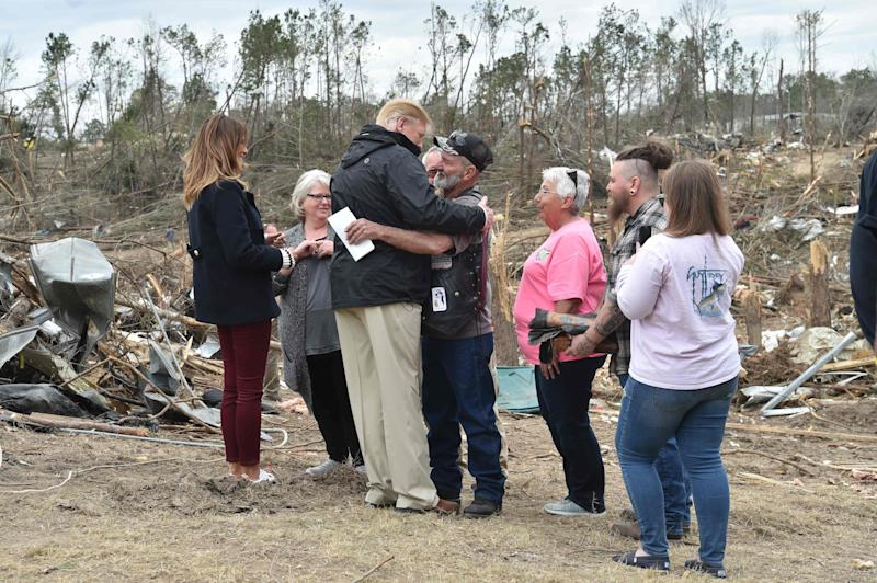 President Donald Trump greets residents during a tour of tornado-affected areas on March 8, 2019 in Beauregard, Alabama.
