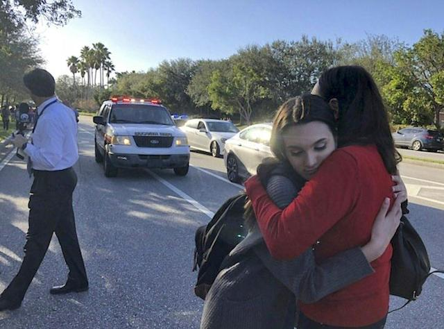 <p>Students react at Marjory Stoneman Douglas High School in Parkland, Florida, a city about 50 miles (80 kilometers) north of Miami on Feb. 14, 2018 following a school shooting. (Photo: Michele Eve Sandberg/AFP/Getty Images) </p>