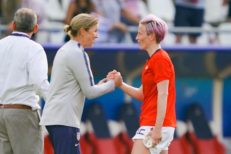 REIMS, FRANCE - JUNE 24: USA women's head coach Jill Ellis celebrates with Megan Rapinoe #15 after a 2019 FIFA Women's World Cup France Round of 16 match between Spain and the United States at Stade Auguste-Delaune on June 24, 2019 in Reims, France. (Photo by John Todd/isiphotos.com/Getty Images).