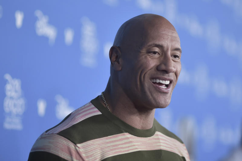 Dwayne Johnson attends the Go Behind the Scenes with the Walt Disney Studios press line at the 2019 D23 Expo on Saturday, Aug. 24, 2019, in Anaheim, Calif. (Photo by Richard Shotwell/Invision/AP)
