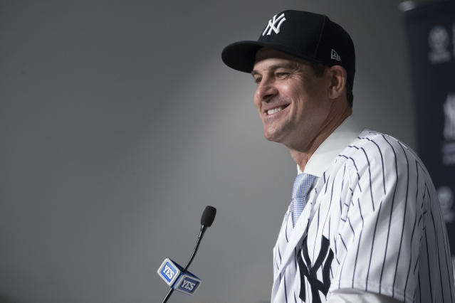 Aaron Boone cracked some jokes with the media at his first press conference as Yankees manager. (AP Photo/Mary Altaffer)