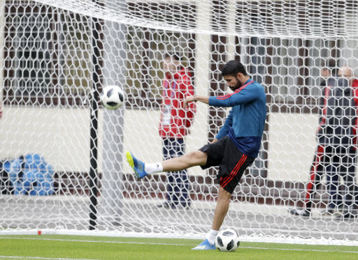 Spain's Diego Costa kicks the ball during the official training on the eve of the group B match between Morocco and Spain at the Mirny stadium in Kaliningrad, Russia, Sunday, June 24, 2018. (AP Photo/Petr David Josek)