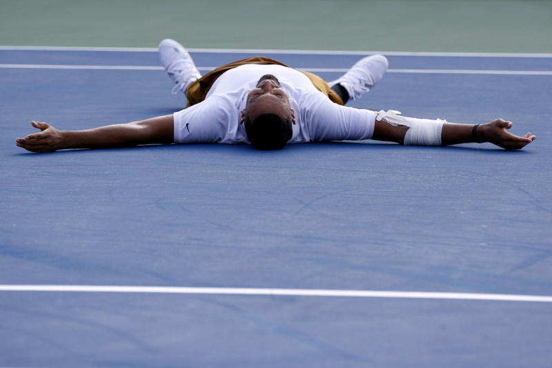 Nick Kyrgios, of Australia, falls to the court as he reacts after defeating Daniil Medvedev, of Russia, in a final match at the Citi Open tennis tournament, Sunday, Aug. 4, 2019, in Washington. (AP Photo/Patrick Semansky)