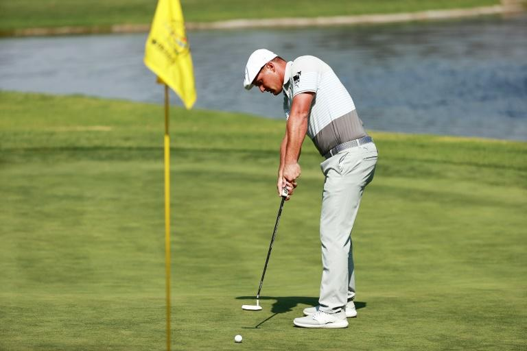 American Bryson DeChambeau drains a 23-foot putt at the sixth hole on the way to an eight-under par 63 and the 36-hole lead in the WGC-Mexico Championship (AFP Photo/Hector Vivas)