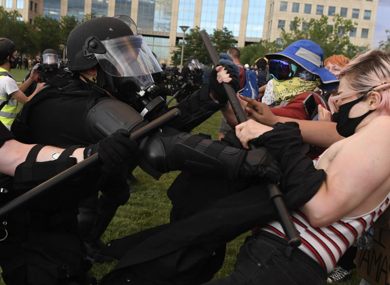 Aurora police officers clash with protesters