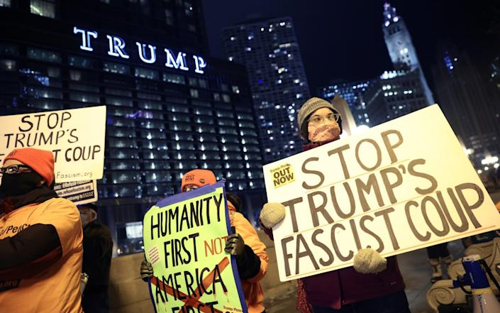 A small group of demonstrators protest near Trump Tower in Chicago - Scott Olson/Getty