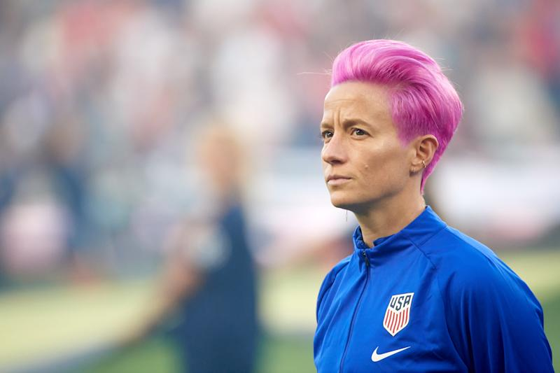 U.S. Soccer will no longer require national team players to stand for the national anthem. The rule was introduced after USWNT star Megan Rapinoe (second from left) knelt to protest social injustice in 2016. (Photo by Hannah Foslien/Getty Images)