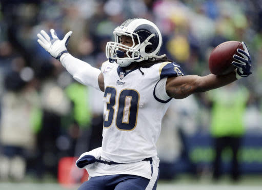 FILE - In this Oct. 7, 2018, file photo, Los Angeles Rams running back Todd Gurley celebrates after scoring a touchdown during the second half of an NFL football game against the Seattle Seahawks in Seattle. With the second-place Seahawks (4-4) visiting the Coliseum on Sunday for the rematch, the Rams (8-1) have a chance to essentially end the division race with seven weeks to go. (AP Photo/Scott Eklund, File)