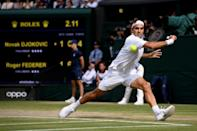 Epic defeat: Federer in action against Novak Djokovic in the record-setting 2019 final