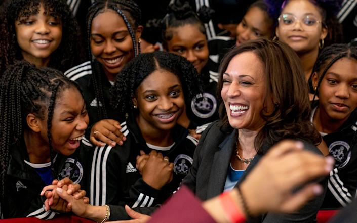Harris greets members of the Detroit Youth Choir at a vaccine mobilisation event