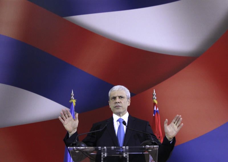FILE - March 2, 2012 file photo of Serbia's President Boris Tadic as he speaks and gestures during a press conference, in Belgrade, Serbia. Tadic said Wednesday April 4 2011 that he is resigning, paving the way for an early presidential election where he will face a strong challenge from a nationalist candidate. In the presidential vote, Tadic will be challenged by nationalist candidate Tomislav Nikolic who has received tacit support from Russia. (AP Photo/Darko Vojinovic, file)