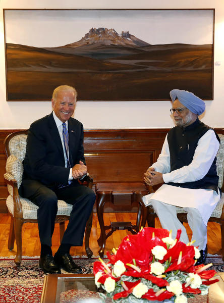 U.S. Vice President Joe Biden, left, and Indian Prime Minister Manmohan Singh are seated for a meeting in New Delhi, India, July 23, 2013. Biden arrived in India on Monday on a trip that will focus on boosting trade and regional security ties and strengthening a strategic partnership that has languished in recent years. (AP Photo/Harish Tyagi, Pool)