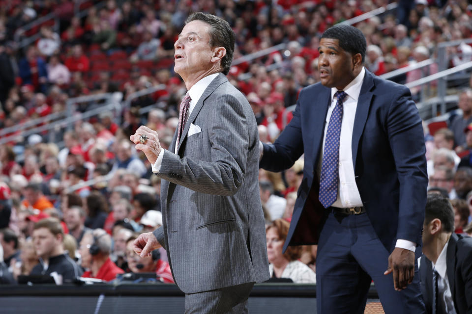 Former Louisville head coach Rick Pitino, left, and former assistant Kenny Johnson during the game against Clemson on January 19, 2017 in Louisville, Kentucky.