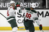Minnesota Wild left wing Ryan Hartman, left, celebrates scoring with left wing Jordan Greenway against the Anaheim Ducks during the first period of an NHL hockey game in Anaheim, Calif., Wednesday, Jan. 20, 2021. (AP Photo/Alex Gallardo)