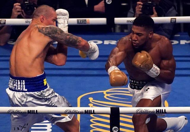 Oleksandr Usyk (left) claimed a dominant points victory over Anthony Joshua