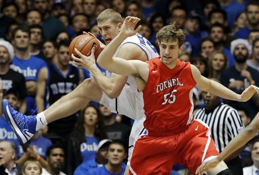 Duke's Mason Plumlee, right, pulls down a rebound against Cornell's Eitan Chemerinski during the first half of an NCAA college basketball game in Durham, N.C., Wednesday, Dec. 19, 2012. (AP Photo/Gerry Broome)