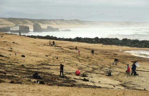 People on the beach Monday at Capbreton, southwestern France, where packages of cocaine have been found in recent days