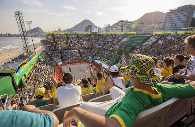 <p>Brazil fans watch their women's team of Barbara Seixas and Agatha Bednarczuk defeat the Czech Republic in a pool play match on Saturday, Aug. 6, 2016, on Copacabana, in the beach volleyball arena, during the Summer Olympics in Rio de Janeiro, Brazil. (Brian Cassella/Chicago Tribune/TNS via Getty Images) </p>
