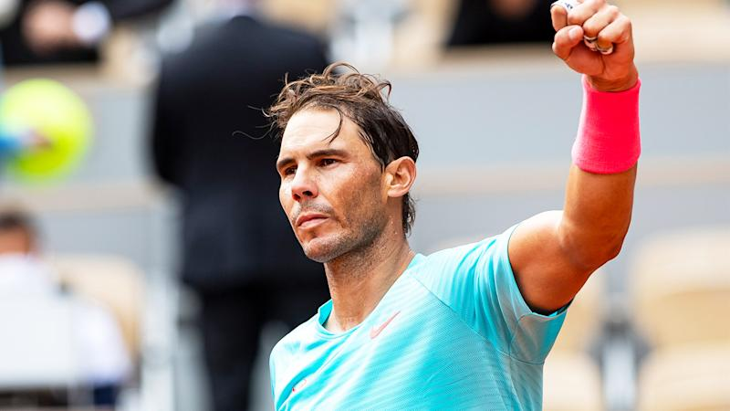Rafael Nadal fist-pumps after victory over Mackenzie McDonald at the French Open.