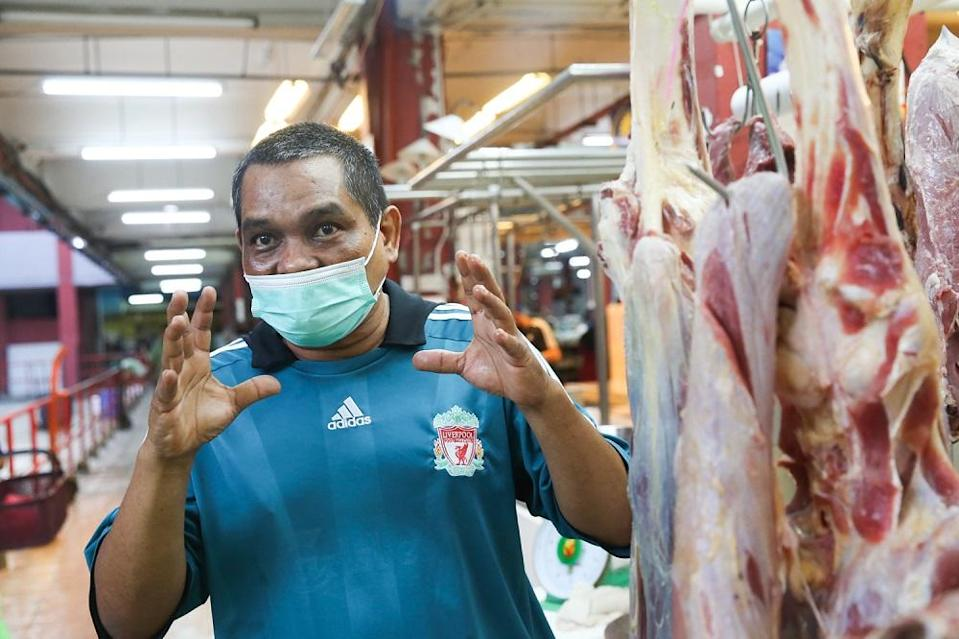 Local and imported frozen beef seller Zamry Shahbhari speaks to Malay Mail at his stall in the PJ Old Town market, December 31, 2020. ― Picture by Choo Choy May
