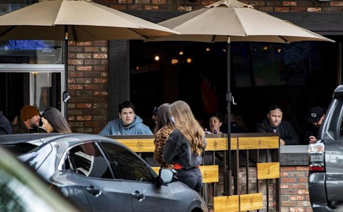 REDLANDS, CA - MARCH 14, 2021: Unmasked customers fill the outdoor seating at a local bar and restaurant on the first day San Bernardino County moved to the Red Tier allowing indoor seating at a limited capacity on March 14, 2021 in Redlands, California.(Gina Ferazzi / Los Angeles Times)