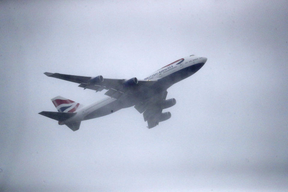 CAPTION OMITS INFO ON DUAL TAKE OFF Aircraft G-CIVY, one of the last two British Airways Boeing 747-400 aircraft takes off for its last flight departure from London's Heathrow Airport, Thursday, Oct. 8, 2020. The retirement of the fleet was brought forward as a result of the impact the Covid-19 pandemic had on the airline and the aviation sector. (Andrew Matthews/PA via AP)